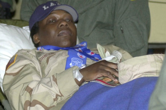 Former prisoner of war Spc. Shoshana Johnson, 507th Maintenance Company, arrives at Landsthul Regional Medical Center, Germany, in April 2003. Johnson suffered gun shot wounds to both ankles when her unit was ambushed by Iraqi forces near Nasiriyah, Iraq, March 23, 2003. She and four other members of her unit were captured and held as POWs.