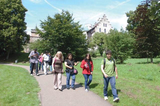 A U.S. Army Garrison Stuttgart Culture College class, accompanied by instructor Edith Hoffmann (center, in brown) strolls the grounds of the Lichtenstein castle July 28.
