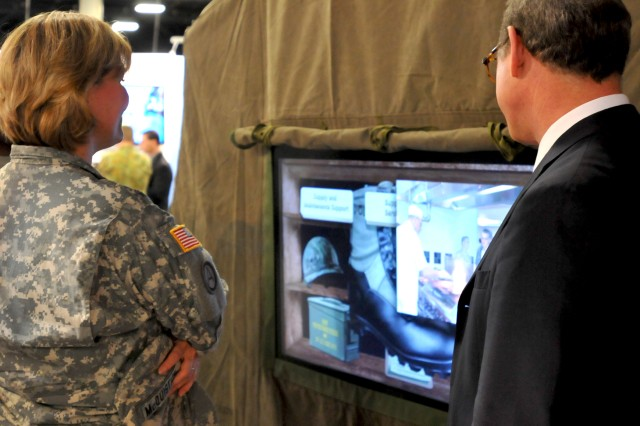Maj. Gen. Patricia McQuistion, Army Sustainment Command's commanding general, visits the ASC display during the United States Army Winter Symposium, held Feb. 22-24 in Fort Lauderdale, Fla.