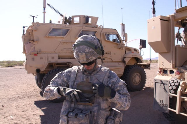 A Soldier demonstrates Nett Warrior, a Soldier-worn mission command system that is under evaluation at the Network Integration Evaluations. Brig. Gen. Randal Dragon, commander of the Brigade Modernization Command, described recent changes to Nett Warrior as an example of the Army taking action to restructure requirements based on Soldier feedback and industry advancement.