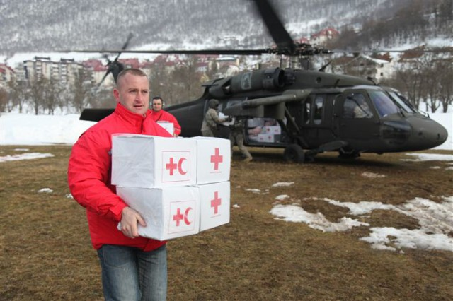 Soldiers from the 12th Combat Aviation Brigade pass supplies to Montenegrin Red Cross workers. Forty Soldiers provided  humanitarian assistance at request of the government of Montenegro to provide relief and to save lives, homes and infrastructure in response to heavy snowfall.