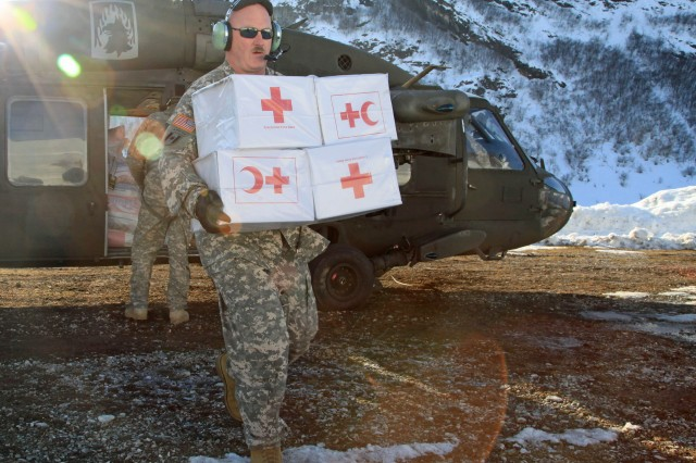 Sgt. 1st Class Richard Simmons from the U.S. Army Europe's 12th Combat Aviation Brigade brings supplies to the citizens of Montenegro under a task force led by 361st Civil Affairs Brigade.