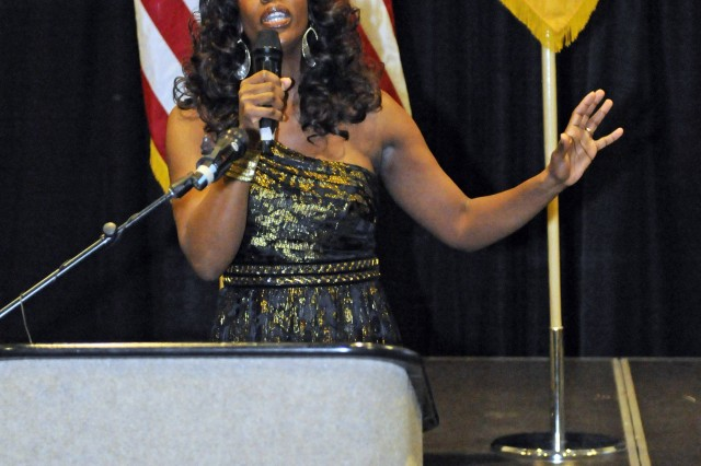 Daisy Ashford sings the National Anthem during the Team Bliss Black History Month Celebration at Fort Bliss, Texas, Feb. 22, 2012.
