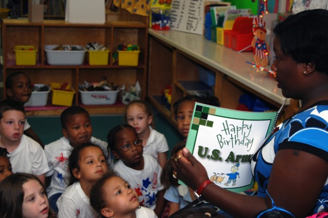 Shoshana Johnson, the first African-American female prisoner of war, reads the Army Birthday Storybook to kindergarteners.