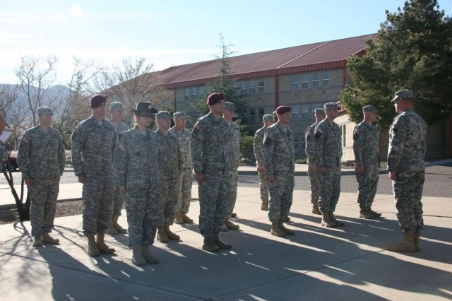 A platoon of Senior Leader Course students at the Military Intelligence Noncommissioned Officer Academy render a salute during a drill and ceremony competition here Jan. 26.