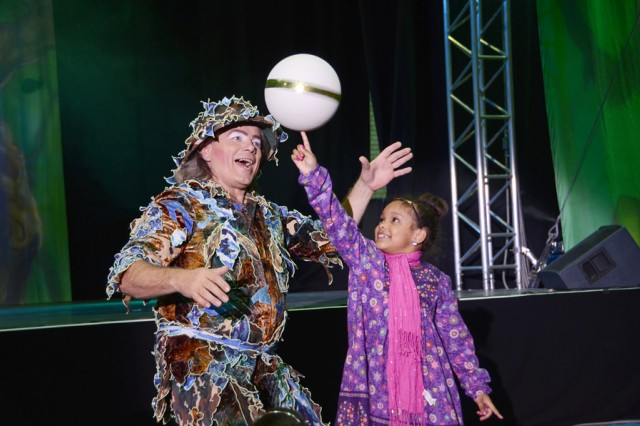 "Kirsten Ray, 6, gets a taste of circus life with the help of ""safari hunter"" Martin Lamberti."