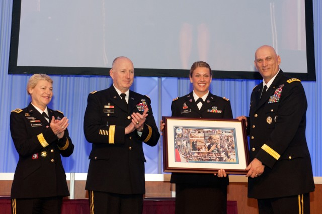 From left, Gen. Ann E. Dunwoody, Gen. Robert W. Cone, and Army Chief of Staff Gen. Raymond T. Odierno, right, present the 2011 Female Athlete of the Year Award to Capt. Danielle Cook at the Association of the U.S. Army Winter Symposium in Ft. Lauderdale, Fl.  Feb. 24, 2012. Dunwoody is the commanding general, U.S. Army Materiel Command, and Cone is the commanding general, U.S. Army Training and Doctrine Command.