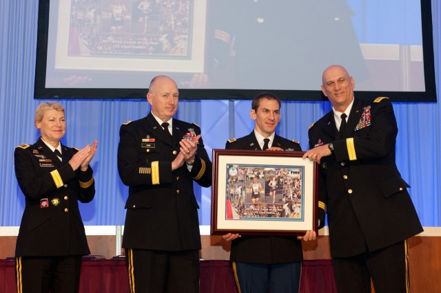 From left, Gen. Ann E. Dunwoody, Gen. Robert W. Cone, and Army Chief of Staff Gen. Raymond T. Odierno, right, present the 2011 Army Coach of the Year Award to Lt. Col. Liam Collins at the Association of the U.S. Army Winter Symposium in Ft. Lauderdale, Fl.  Feb. 24, 2012. Dunwoody is the commanding general, U.S. Army Materiel Command, and Cone is the commanding general, U.S. Army Training and Doctrine Command.
