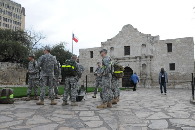 Army South Soldiers pause for a quick break in front of the Alamo in downtown San Antonio during their 18-mile training road march Feb. 23, 2012. The Soldiers are among 35 other Army South Soldiers who will make their way to White Sands Missile Range, N.M., March 25 for the 23rd Annual Bataan Memorial Death March.
