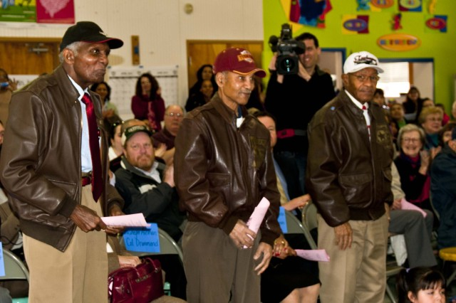 240- LAKEWOOD, Wash.-- Three Tuskegee Airmen, left to right, Tommie Lamb, Edward P. Drummond Jr. and George W. Hickman Jr. are recognized  Feb. 14  during the Tyee Park Elementary School's Black History Month celebration. Honored guests included Tuskegee Airmen and Pearl Harbor survivors. (Photo by U.S. Army Staff Sgt. Teresa. L. Adams, 28th Public Affairs Detachment)