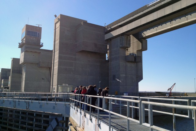 Science, technology, engineering and math students gather on top of the miter gates at the U.S. Army Corps of Engineer's Melvin Price Locks and Dam in Alton, Ill., to learn about lock operations during the Saturday Scholars program Feb. 25, 2012. St. Louis District employees engaged students from 18 high schools in Southwestern Illinois during the event.