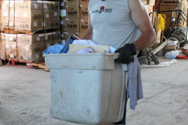 Boston University Cadet Jeremiah Cioffi moves supplies during his recent trip to Haiti.