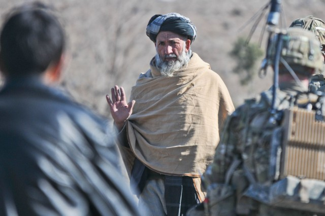 An elder in the village of Narizah greets paratroopers of 3rd Platoon, Blackfoot Company, 1st Battalion (Airborne), 501st Infantry Division, Task Force Blue Geronimo, as they conduct a security patrol in the Tani district, Feb. 10. The 1-501st, based at Joint Base Elmendorf-Richardson, Alaska, is serving in Afghanistan as part of Task Force Spartan.
