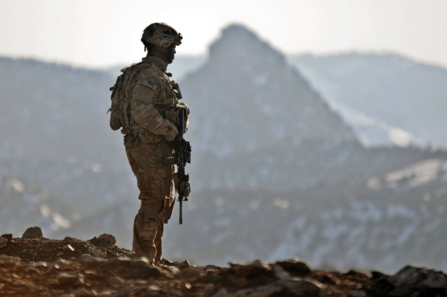 Staff Sgt. Jonathan Price, a squad leader with 3rd Platoon, Blackfoot Company, conducts security checks near the village of Narizah in Afghanistan's Tani district, Feb. 10. The 1-501st, based at Joint Base Elmendorf-Richardson, Alaska, is serving in Afghanistan as part of Task Force Spartan.
