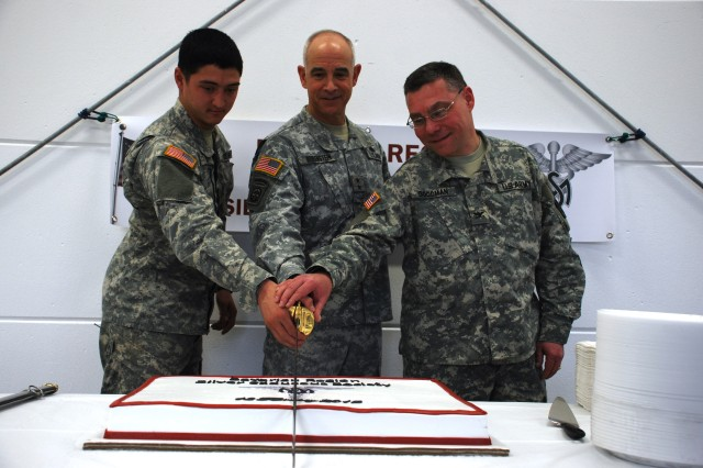 From left to right, 2nd Lt. Virgil Smith, 1st Squadron, 91st Cavalry Regiment, Maj. Gen. David Rubenstein, the chief of the U.S. Army Medical Service Corps and commanding general of the U.S. Army Medical Department Center and School, and Col. Robert L. Goodman, Bavaria Medical Department Activity commander, cut a cake to inaugurate the Bavarian Region Silver Caduceus Society Feb. 13 in Vilseck, Germany. Silver Caduceus Societies are private associations established for Medical Service Corps officers to conduct professional and personal development and offer a forum for the officers to converse about technical, administrative and scientific topics. Rubenstein discussed the importance of mentoring and encouraged the officers to manage their career goals and objectives during his visit.