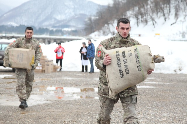 Bags of humanitarian assistance supplies provided by a 7th Civil Support Command-led task force providing humanitarian assistance to snowbound Montenegro, are carried by Montenegrin Army Soldiers. The 7th CSC's 361st Civil Affairs Brigade is providing mission control of the operation, while the 12th Combat Aviation Brigade and other U.S. Army Europe units are providing two Black Hawk Helicopters and support elements as part of a U.S. task force to provide humanitarian assistance at request of the government of Montenegro coordinating with the National Emergency Operations Center and the Montenegrin Ministry of Defense to provide relief and to save lives, homes and infrastructure in response to heavy snowfall.