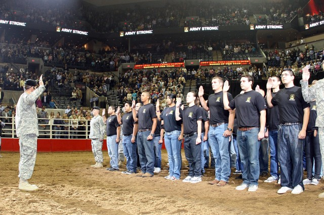 "SAN ANTONIO "" Lt. Gen. William B. Caldwell IV, commander, U.S. Army North, and senior commander, Fort Sam Houston and Camp Bullis, swears in 34 young men and women who committed to support and defend the U.S. Constitution from all enemies in front of thousands of witnesses from the San Antonio community at a sold-out AT&T Center.  The future Soldiers swore the oath during the opening ceremonies of Military Appreciation night at the San Antonio Livestock Show and Rodeo."