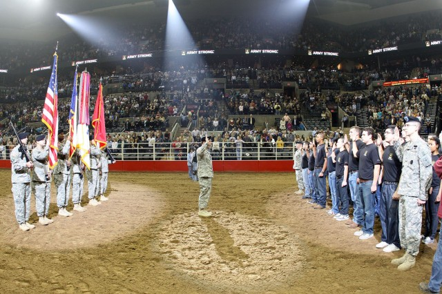 "SAN ANTONIO "" Lt. Gen. William B. Caldwell IV, commander, U.S. Army North, and senior commander, Fort Sam Houston and Camp Bullis, swears in 34 young men and women who committed to support and defend the U.S. Constitution from all enemies in front of thousands of witnesses from the San Antonio community at a sold-out AT&T Center.  The future Soldiers swore the oath during the opening ceremonies of Military Appreciation night at the San Antonio Livestock Show and Rodeo. (U.S. Army photo by Col. Wayne Shanks, Army North PAO)"