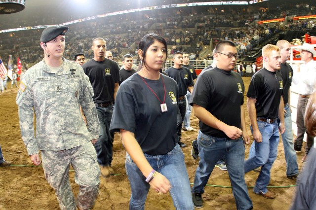 "SAN ANTONIO "" Thirty-four young men and women, who committed to support and defend the U.S. Constitution from all enemies in front of thousands of witnesses from the San Antonio community at a sold-out AT&T Center, march out of the arena.  The future Soldiers swore an oath administered by Lt. Gen. William B. Caldwell IV, commander, U.S. Army North, and senior commander, Fort Sam Houston and Camp Bullis, during opening ceremonies of Military Appreciation night at the San Antonio Livestock Show and Rodeo. (U.S. Army photo by Col. Wayne Shanks, Army North PAO)"