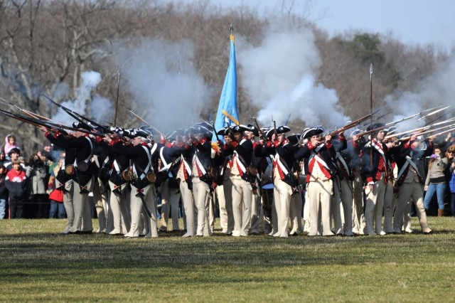 "Soldiers of the Commander in Chief's Guard, 3rd U.S. Infantry Regiment (The Old Guard) fire their ""Brown Bess"" muskets from the defense against cavalry position during a firing demonstration at Mount Vernon, Va., Feb. 20. The Brown Bess is a .50 caliber smooth bore musket that was used by American forces during the Revolutionary War."