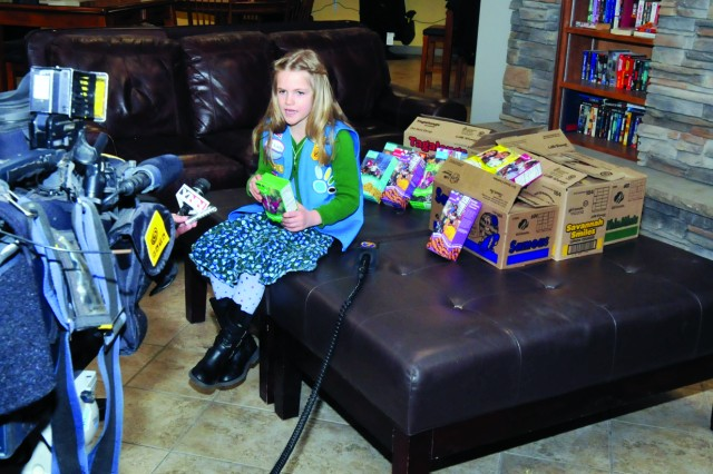 Annabelle appears before local TV stations at the USO on post Feb. 24 to answer questions about her donation to the troops.
