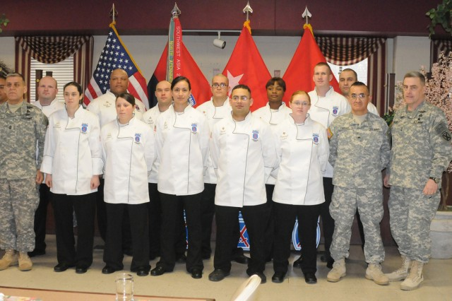 Fort Drum and 10th Mountain Division (LI) command team poses with the installation's culinary arts team Feb. 22. The team provided a gourmet three-course meal for commanders and senior enlisted leaders in preparation for the U.S. Army Culinary Arts Competition, which is taking place at Fort Lee, Va., through March 9. From left, Staff Sgt. Carlos Quiles, Division Command Sgt. Maj. Rick Merrit, Staff Sgt. Michael Bogle, Pvt. Kara McKittrick, Sgt. David Allen, Pfc. Kelsee Demass, Sgt. David Cantwell, Pfc. Iris Trejo, Spc. Jaime Contreras, Spc. David Navarro, Spc. Markeeshia Neal, Spc. Shawnah Collett, Spc. Daniel Parks, Sgt. 1st Class Leonard Phillips, Sgt. Marco Yapias and Maj. Gen. Mark A. Milley, Fort Drum and 10th Mountain Division (LI) commander.