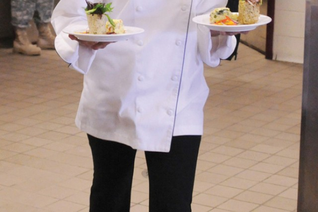 Spc. Iris Trejo brings out appetizer plates to hungry guests.