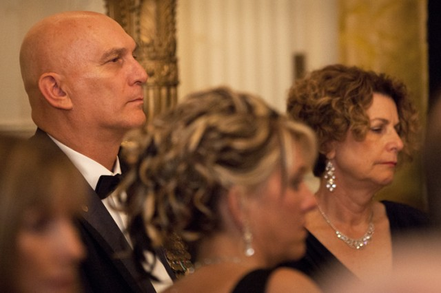 """Army Chief of Staff Gen. Raymond T. Odierno listens as troops who served in Iraq are addressed during """"A Nation's Gratitude Dinner"""" hosted by President Barack Obama and First Lady Michelle Obama at the White House Feb. 29, 2012. The dinner included men and women in uniform from all ranks, services, states and backgrounds."""