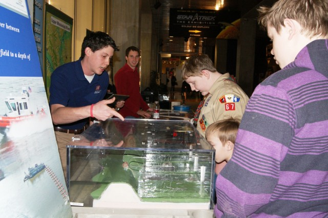 U.S. Army Corps of Engineers' Jose Lopez explains the science behind building a levee to children Feb. 25 during Engineer Week at the St. Louis Science Center. (U.S. Coast Guard photo)