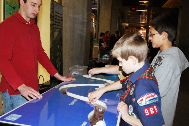 U.S. Army Corps of Engineers' Bryan Dirks explains the science behind building a levee to children Feb. 25 during Engineer Week at the St. Louis Science Center. (U.S. Coast Guard photo)