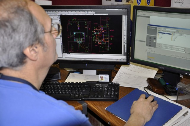 Watervliet Arsenal Tool Designer John Zullo builds a 3-D sketch of a special tool that will be needed to support a new order for a weapon system.  Zullo has been a tool desiger at the Arsenal since 1975.  When he started, he had to do these sketches on a draftsman table, which he still has.
