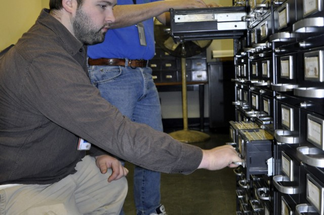 Greg Tilley, left, and John Zullo comb through the various tool card drawers to demonstrate the degree of detail that each historical record holds.  Some of these records date back to the Korean War.