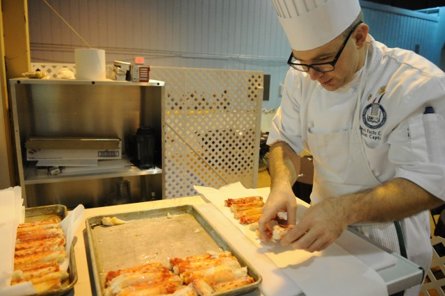 U.S. Coast Guard Petty Officer 1st Class Edward Fuchs prepares crab to be cooked during the Field Competition in Fort Lee, Va., February 29, 2012. All military branches competed in several categories during the 37th Annual Military Culinary competition. (U.S. Army photo by Spc. Daneille Hendrix)