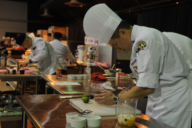 USA Culinary Team members and Canada Culinary Team members prepare ingredients for the International 2-Chef Mystery Competition in Fort Lee, Va., February 29, 2012. All military branches competed in several categories during the 37th Annual Military Culinary competition. (U.S. Army photo by Spc. Daneille Hendrix)