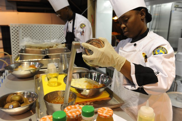 U.S. Soldiers with the Hawaii Culinary Team prepare dishes for the Field Competition in Fort Lee, Va., March 01, 2012. All military branches participated in various culinary categories during the 37th Annual Military Culinary Competition. (U.S. Army photo by Spc. Daneille Hendrix)
