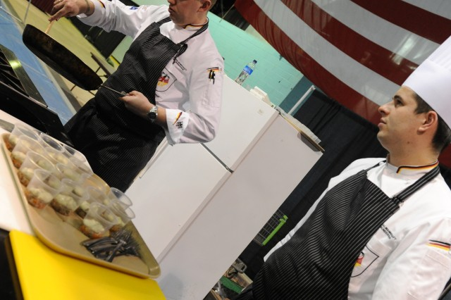 The German Army Culinary Team prepares a dish during a live demonstration in Fort Lee, Va., March 01, 2012. All military branches participated in various culinary categories during the 37th Annual Military Culinary Competition. (U.S. Army photo by Spc. Daneille Hendrix)