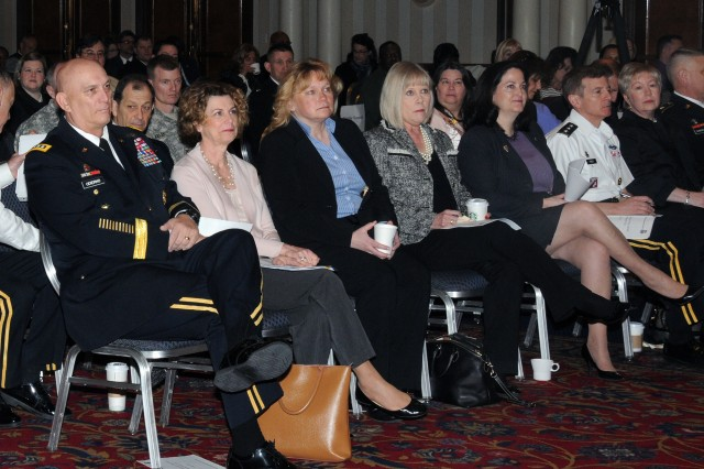 Gen. Raymond T. Odierno, chief of staff of the Army, and his wife, Linda, are surrounded by Army Family Action Plan attendees, as he awaits his turn to speak, March 2, 2012, at the AFAP conference.