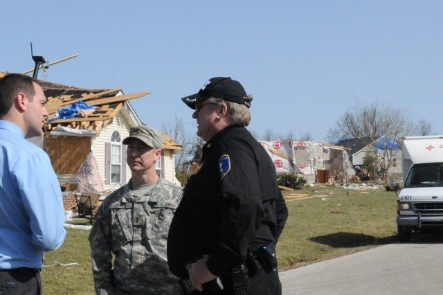 Second Lt. Sean Jones meets with local authorities in LaRue County, Ky., March 1, 2012, to coordinate the Kentucky National Guard mission following the tornado that struck the community of Hodgenville, Feb. 29, 2012.