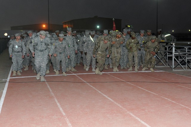 Service members began the grueling Bataan Memorial Death March at the Zone 1 track at Camp Arifjan, Kuwait, March 1, 2012. The event called not only for participants to complete the 12.5 mile course, but also to carry at least 35 pounds in their ruck sack. Third Army is honoring the service members who defended the Philippine Islands during World War II.