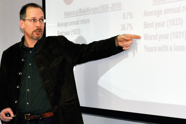Mark Vehr, a volunteer with Wiesbaden Army Community Service financial readiness, teaches a class on how to save money at the Wiesbaden Entertainment Center during Military Saves Week.