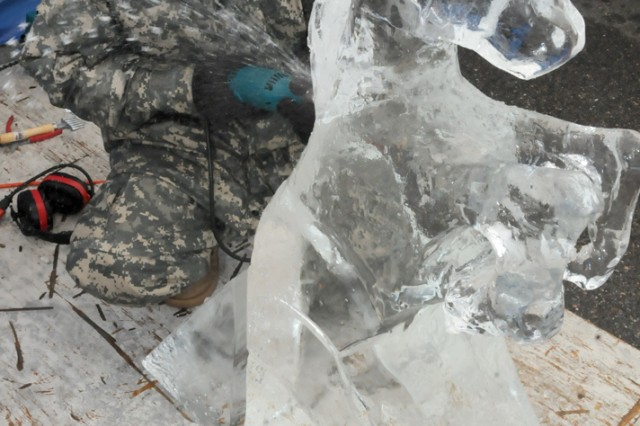 Spc. John Philipp puts the final touches on his project during the single category in the ice carving event of the Military Culinary Arts Competititon March 2, 2012, at Fort Lee, Va.  Philipp is a member of the Fort Hood, Texas, Culinary Team.