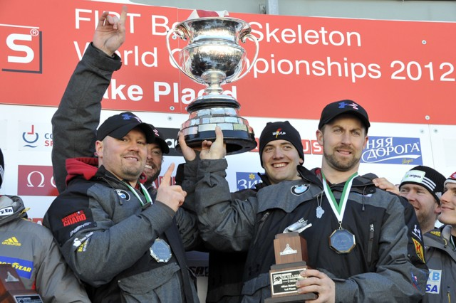 Left to right: Steven Holcomb, Steve Langton, U.S. Army World Class Athlete Program bobsledder Spc. Justin Olsen and Curtis Tomasevicz hoist the four-man champions' trophy at the 2012 FIBT World Championships in Lake Placid, N.Y. Courtesy photo by Faye Hendrick