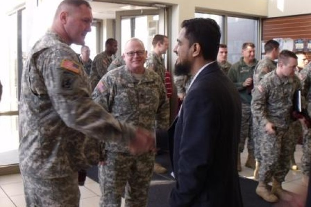 Capt. Patrick Seaman, commander of Bravo Company, 412th Civil Affairs Battalion, shakes hands with Shakeel Muhammad, a member of Noor Islamic Cultural Center Feb. 26, 2012 in Dublin, Ohio.