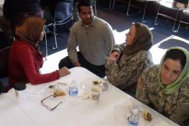 Asim Haque, a volunteer and member of Noor Islamic Cultural Center's board of directors, center, speaks with members of the 412th Civil Affairs Battalion Feb. 26, 2012in Dublin, Ohio.  Zeenath Sheikh is on the left, wearing a brown scarf, Sgt. Leah Fitch and Spec. Tara Campbell are pictured center to right.