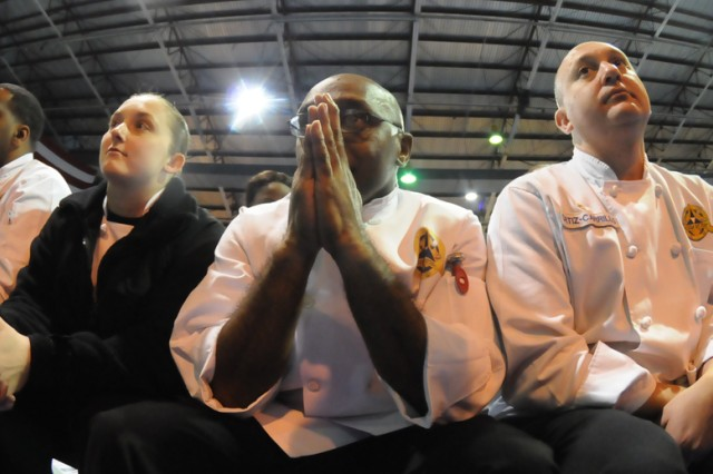 Members of the Fort Hood (Texas) Culinary Arts Team, led by Master Sgt. Anthony Roscoe (with hands together), await the medal results after one of the events during the Military Culinary Arts Competition Feb. 29.