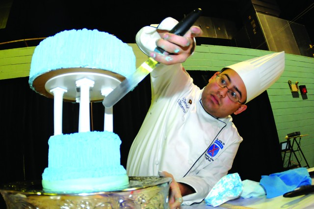 Spc. David Navarro, Fort Drum (New York) Culinary Arts Team, applies icing to a cake Feb. 29.  Navarro was competing in the 37th Annual Military Culinary Arts Competition at Fort Lee, Va.