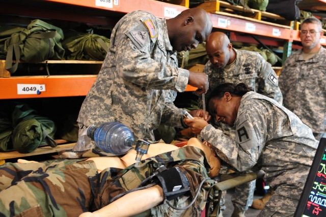 Soldiers from around First Army Division East attempt to clear the airway of the Laerdal SimMan patient simulator during a four day familiarization course held in September at the Regional Training Site-Medical located at Fort Gordon, Georgia.  (U.S. Army Photo by Staff Sgt. Amburr Reese, First Army Division East Public Affairs)