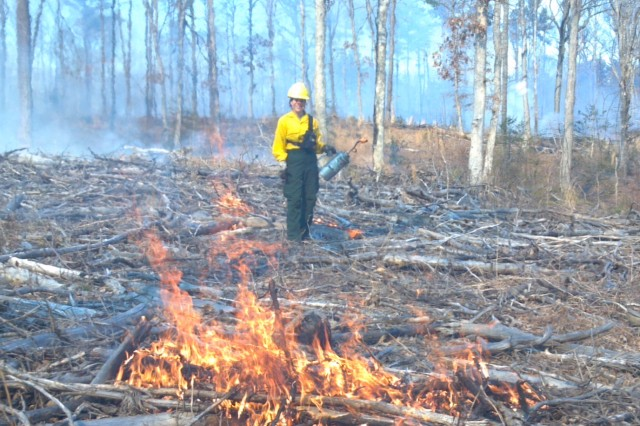 Beth Cantrell of the forestry branch ignites a portion of a training area on Fort A.P. Hill during a prescribed burn Feb. 28.