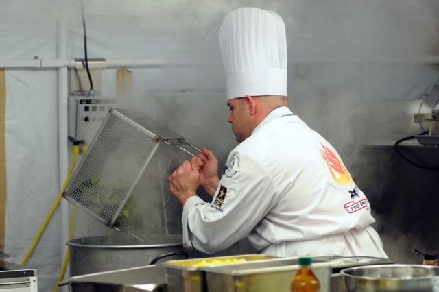 Spc. Juan Dejesus, part of the Fort Polk, La., team, prepares vegitables during the field competition at the 37th Annual Culinary Arts Competition, Feb. 9 - March 7, 2012, at Fort Lee, Va.