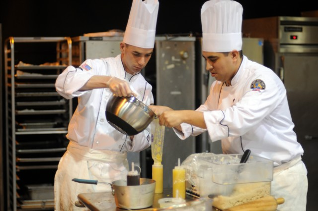 Sgt. Isaac Wilson and Spc. Cesar Espino, from Fort Sill, Okla., prepare deserts for the field competition at the 37th Annual Culinary Arts Competition, Feb. 9 - March 7, 2012, at Fort Lee, Va.